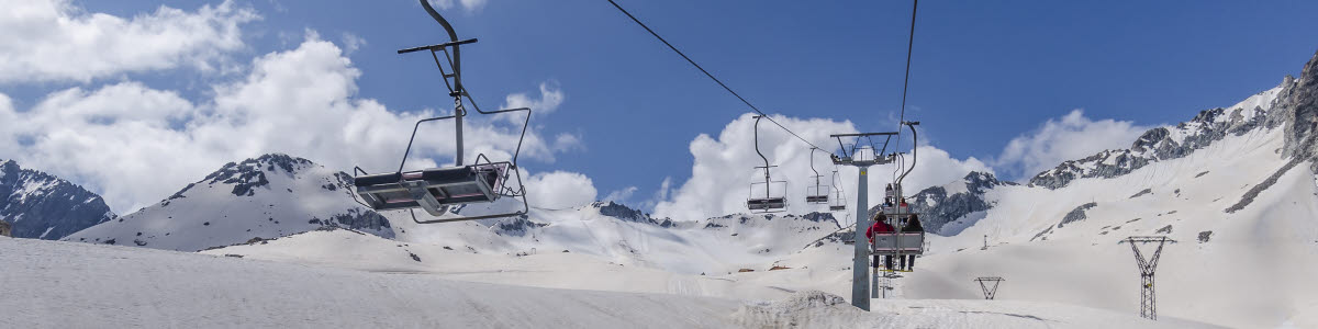 Cable car for skiers in the mountains of Northern Italy Alps on a clear sunny day