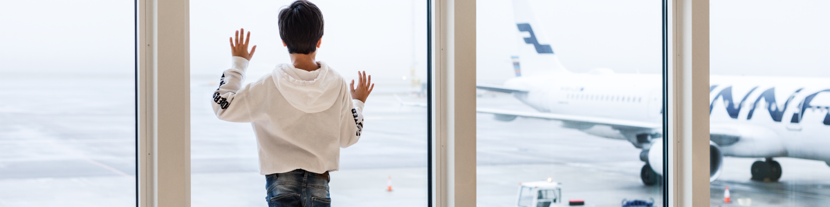 A boy is looking through the terminal window