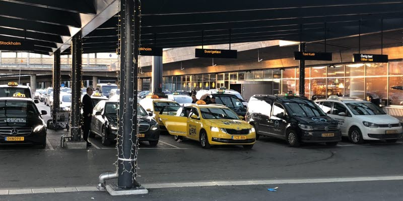 Taxis standing under a roof
