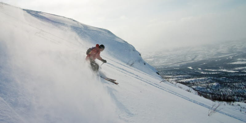 A person skiing down a hill