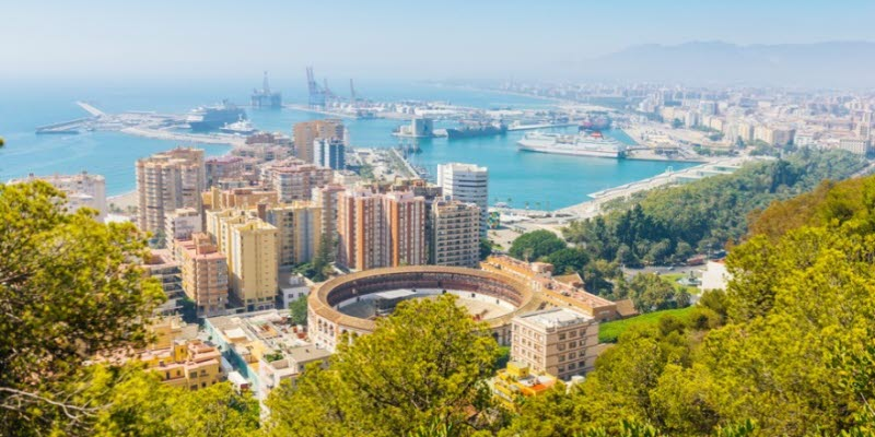 View of Malaga with bullring and harbor. Spain